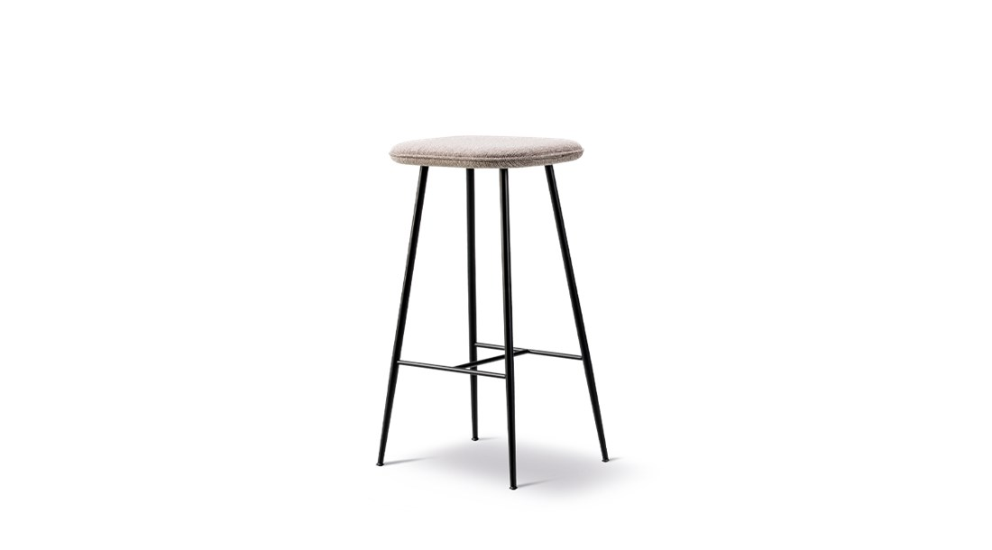 Spine Metal Base Stool - A clean and modern visual language characterises the Spine collection, and this latest addition of a metal base strengthens the stunning expression of the family. The simple lines of the metal leg infuse the chair with a sleekness that contrasts perfectly with the plush, fully-upholstered seat, creating a beautifully balanced design. Spine signals a dynamic design language driven by strong lines balanced by subtle curves. Contrasts that merge into a singular, balanced entity. Solid and graphic yet soft and organic.   The design is anchored in Nordic tradition but with a sophisticated, modern twist that gives it a striking, fresh aesthetic.   The Spine series has expanded since its initial launch to encompass a variety of products and a growing number of variants, found in deluxe restaurants, bars, hotels and exclusive retail shops worldwide.   Adding a touch of tension and dimension is the interplay between the upholstery and the base, available in either wood or metal. Spine in wood is classic and luxurious, exuding a certain strength of character. Whereas the sleekness of the metal base signals a look that's more modern and light. The upholstery is inspired by techniques that were developed at our Fredericia workshop for Børge Mogensen's exclusive 1960's leather series.   With its graceful appearance, Spine is all about contrasting elements that culminate in a cohesive concept that's inviting wherever you place it. | Matter of Stuff