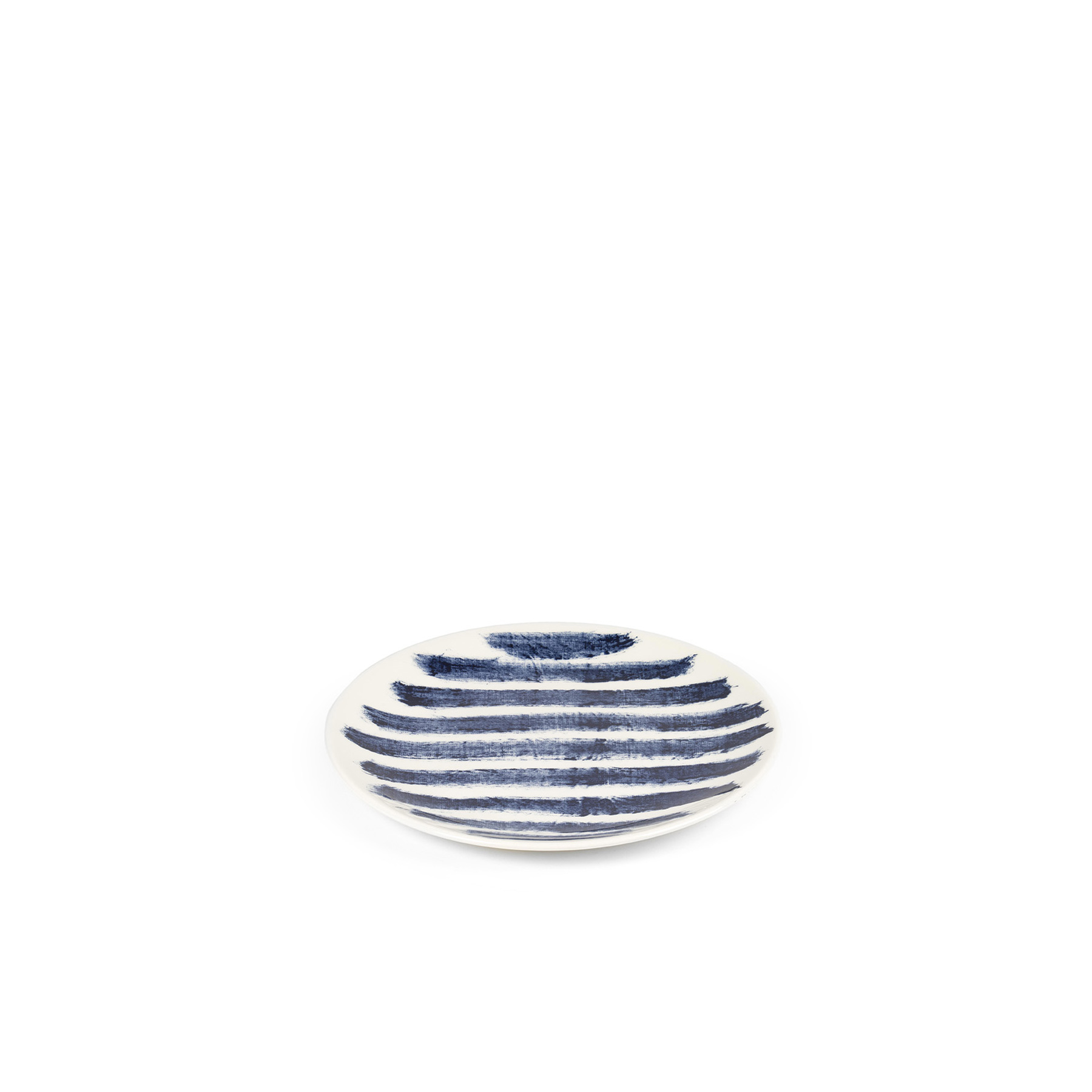 Indigo Rain Salad Plate - Faye Toogood's addition to her range of ceramic designs for 1882 Ltd. puts a fresh spin on the forms and traditions of English creamware. Indigo Rain reinterprets the homely familiarity of blue-and-white striped crockery in a new design informed by the spirit of serendipitous discovery. Representing a streamlined take on our ceramic heritage, the fine earthenware employs the familiar tones of English Delftware: cream offset with a rich, deep blue. Broad bands of indigo glaze, like painterly washes of watercolour, are applied to rough canvas and then transferred to the pieces – the characteristic grain of the fabric imbues the delicate ceramics with the hardworking spirit of dark-dyed denim.  | Matter of Stuff