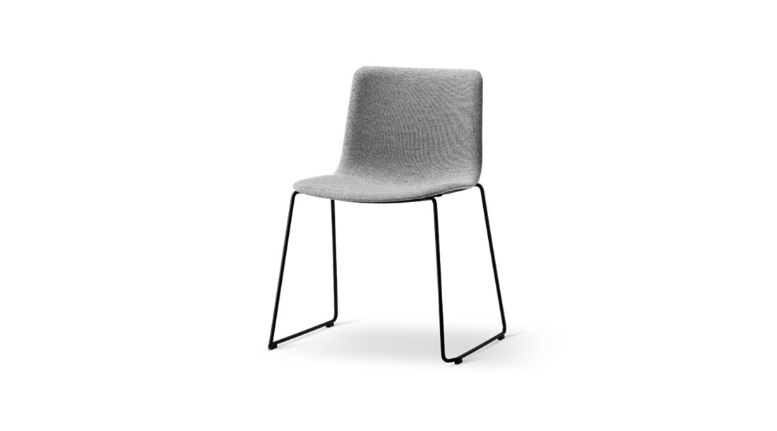 Pato Sledge Base Chair Fully Upholstered - Pato is a carefully crafted multipurpose chair in eco-friendly polypropylene that can be used outdoors. The chair is available with a range of optional features including coupling. The chair can be tuned from basic to exclusive with optional upholstery.  Pato is a prime example of our focus on sustainability and protecting the environment, reflected in a chair that's 100% renewable and recyclable. All components can be incorporated into future furniture production, thus contributing to a circular economy by minimising the use of materials, resources, waste and pollution.   Merging traditional production methods with cutting-edge technology, Pato is a human-centric, highly versatile series of multi-purpose functional furniture that draws on our in-depth experience with materials, immaculate detailing and heritage of fine craftsmanship. Allowing us to apply our high standards of texture, finish and carpentry techniques to an array of materials in addition to wood for products aimed at a mass market.   With its clean lines and curves, Pato echoes the ethos of Danish-Icelandic design duo Welling/Ludvik. Demonstrating their belief that good design has the ability to be interesting, even when reduced to its most simple form. Where anything extraneous is eliminated and every detail has a purpose.   Together we spent nearly three years developing the shell structure to have a soft surface that's also wear and tear resistant. Enhancing the chair's ability to optimally conform to the user's body is a subtle beveled edge. A technique from classic cabinetmaking, which gives the chair a sense of handcrafted finesse. Each Pato is detailed and finished by hand by our highly skilled crafts people, who refine the beveled edge and the silky, resilient surface. Setting a new standard for the execution and finish of polypropylene.   Since the success of its initial launch, we've expanded Pato into an extensive collection of variants, featuring