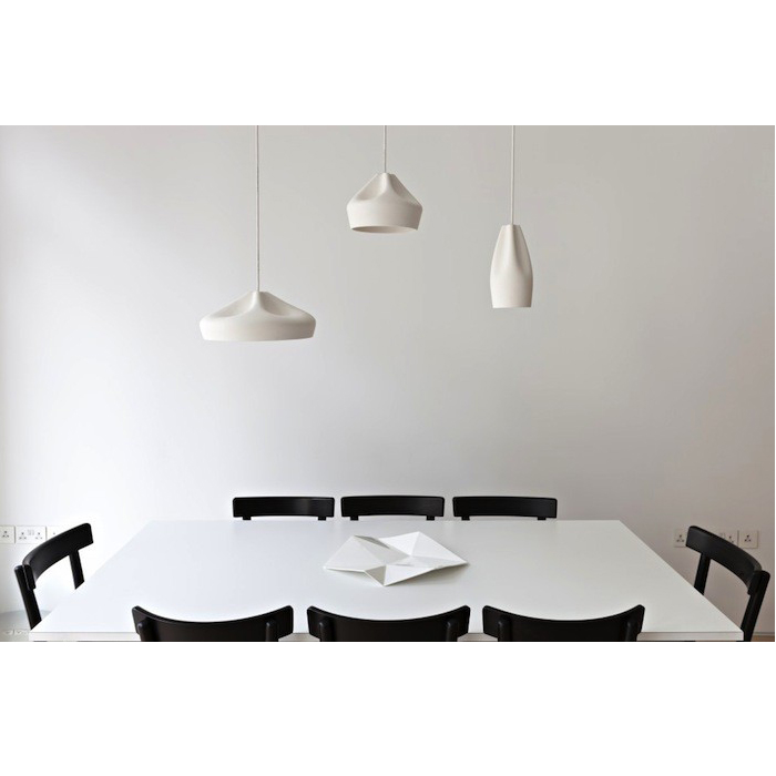 Pleat Box 47 Pendant Light - <p>The idea behind the Pleat Box is a sophisticated combination between a digitally designed crease in a piece of cloth and a silhouette that is applied to a ceramic base.</p> <p>The outer part of the lamp is offered in white ceramic, brown, black, terracotta, and grey– the direct result of recycling different enamels. The interior is available in brilliant white enamel, which enhances the luminous light from the lamp, or 24k gold, which generates an extremely warm light.</p> <p>The Pleat Box collection is now available with an integrated LED technology, which projects indirect light and prevents glare.</p>  | Matter of Stuff
