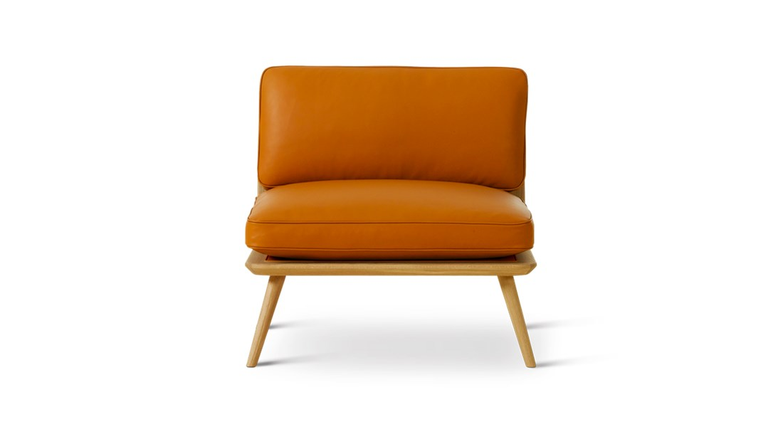 Spine Lounge Suite Chair - The Spine Lounge pays respect to the traditions of hand upholstering to which Fredericia built its name on, while offering a modern flavour in its own succinct and simple way.  Curved corners, ample cushions and somewhat low to the ground, Spine Lounge is a testament to simplicity as the ultimate form of exclusivity. What began as a Spine Lounge Chair for a Michelin-star restaurant has expanded into an entire series with the same signature approach, encompassing the Spine Lounge Suite, Spine Petit, Spine Daybed, Spine Sofa and Spine Bench. An array of variants that easily lend themselves to all kinds of scenarios in the high-end hospitality and retail sector, as well as private residences.   What they all share is a soft, plush cushioned side for comfort supported by a singular structure in solid wood. Incorporated into the structure are slightly splayed legs at either end, which signal a sense of relaxed informality.   The upholstery draws on Fredericia's signature techniques, with a modern spin. Discrete details on various versions, such as the leather piping around the sides, add to the series' subtle sophistication.   The result is a succinct design that's soft yet solid. Fluid yet structured. Poetic yet purposeful. Able to exude, at a glance, an ambience of elegance.   | Matter of Stuff
