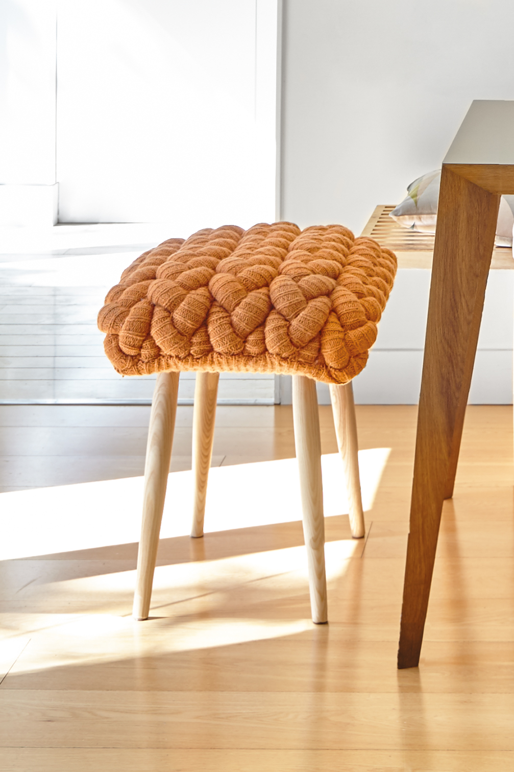 Knitted Orange Stool - <p>Craft, with a touch of magic. Inspired by real stitches and woven yarns, these knitted stools magnify the concept and make it into a completely new item: a comfy seat. This stool has been hand kitted and due to the handmade nature of the GAN product, slight variations in size, colour, finish are normal. </p>  | Matter of Stuff