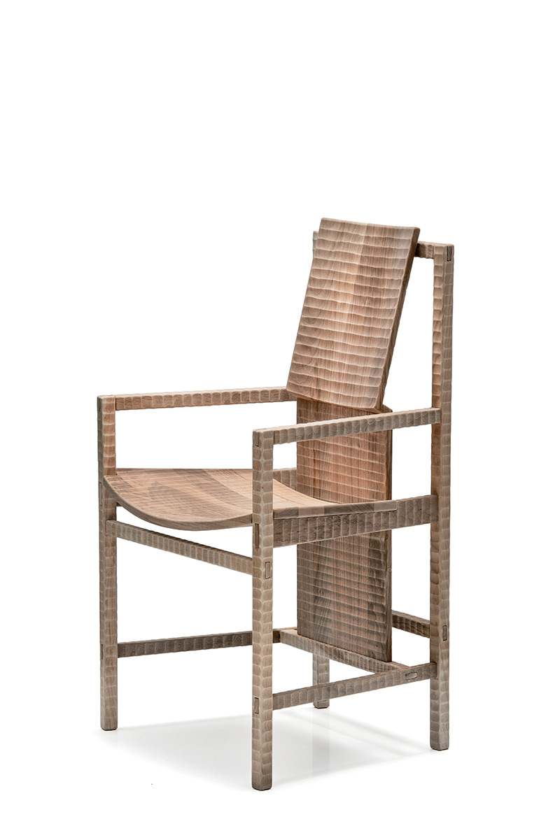 """Pisana Armchair - <p>Pisana is a chair with solid wood structure assembled by interlocking. Finished on all sides by plane and gouge. The entire manufacturing and finishing process is carried out manually in our workshop. The wood used for this piece is Juglans Regia – common Italian walnut; not dried but """"raw"""". This wood belongs to the Latin tradition of furniture-making and features an extremely compact fibre which can, however, be worked without too much difficulty; it is therefore highly suitable for household items. Over time the wood hardens and becomes extremely resistant, and oxidises slightly to take on a progressively warmer amber colour. Customised and made with European cherry, Slavonian oak, maple.</p>  