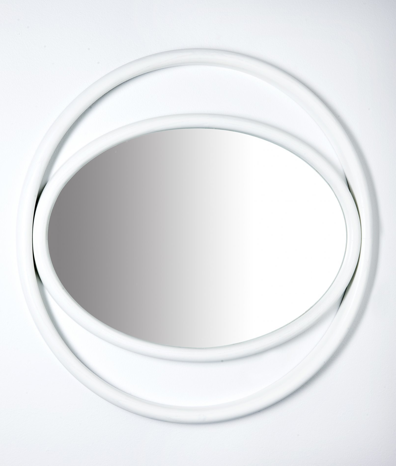 Eyeshine Mirror - Simple geometric shapes, a combination of circles and ovals, recreate scenic suggestions that bring to mind the mystical powers of the eye and delineate the outline of the Eyeshine mirrors devised by the designer Anki Gneib. The steam-bent ash encloses the reflecting surface and shows different sizes, expanding the eye's searching echo.  | Matter of Stuff