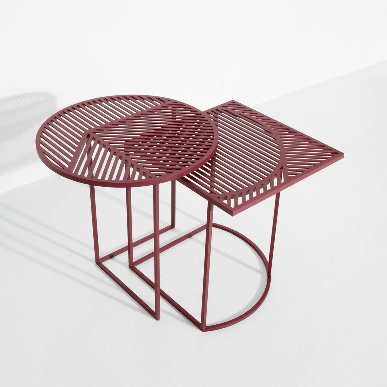 ISO A Side Table - With these two side-tables ISO-A (round) and ISO-B (square), POOL studio reaffirms its hyper graphic style. Each one of these tables taken individually highlight a pattern; the two tables presented together create a new one: their superposition gives birth to a «moiré» effect, and the pattern becomes alive.