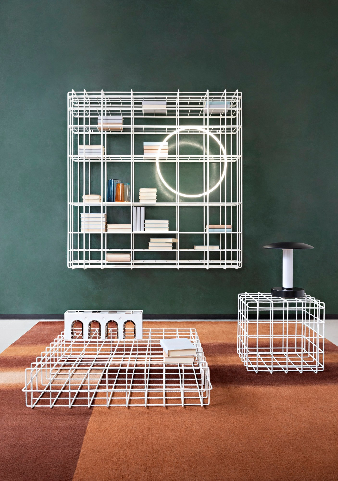 Leyva Wall-Mounted Bookcase -  Leyva is a latticework bookcase in coated and soldered tubular iron with a clean-cut and essential silhouette.‎ Its willowy minimal contours conjure up an airy lightness.‎ Whether it is wall-mounted or free-standing, it will easily blend into any setting.‎ 