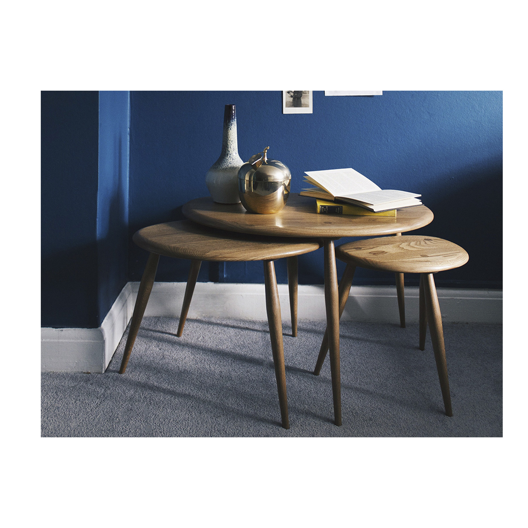 """Originals Nest Of Tables - <p>Offering maximum flexibility, this classic piece of furniture comprises three individual tables where the smaller tables slot neatly underneath the large one to save space when not in use. The fluid curves and tapered table legs offer a simple and distinctively ercol design.<br /> This furniture will be finished in your choice of a selection of lacquer finishes or in a choice of our painted colour finishes, which protect the timber as well as fitting in with your style and decor. The 354 nest is affectionately known as the """"pebble"""" nest owing to the shape of the table tops.</p>  