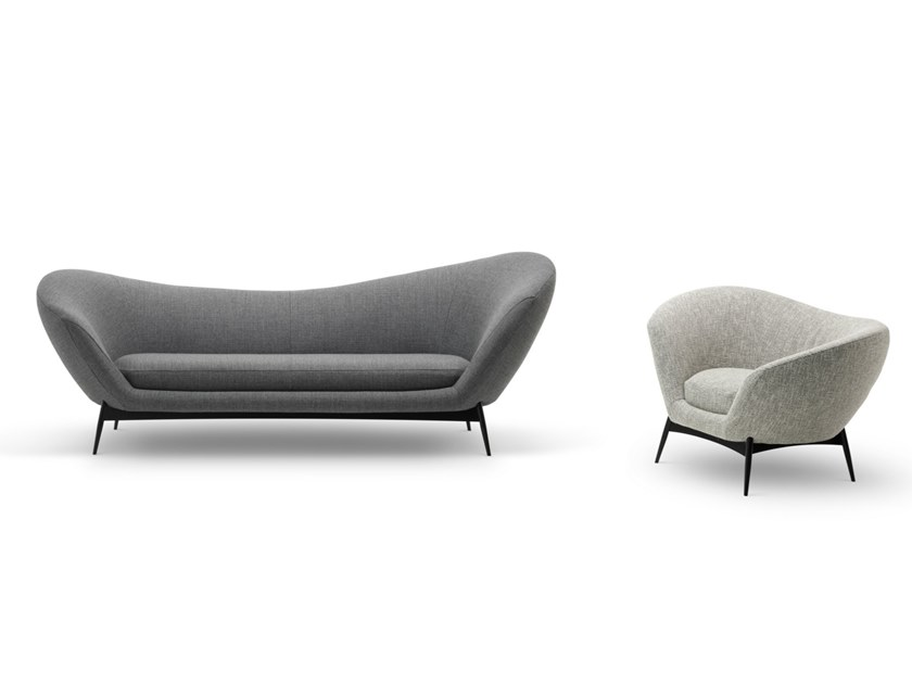 """Oltremare Lounge Armchair - The asymmetric curves are the inspirations for the Oltremarearmchair that completes the collection alongside a padded bench. A comfortable nest suspended on a slim varnished wood base, whose essential linesrender, by contract, the armchair's silhouette even more interesting.  Additional removable cover is available, please enquire for prices.  The seating collection """"Oltremare"""" designed by Antonio Marras and produced incollaboration with Saba, stems from a far-away past and place, full of history,recollection, memories overflowing with suggestions and visions. By observing itssinuous silhouette, who boosts Sardinian origins, can even catch sight of a familiarpromontory and a small island, a fragment of the coast that in ancient times separateditself from the main land. A sofa can accompany us along the fascinating journey of our life, """"it becomes one of us,a friend staying over, staying so well that he doesn't want to leave"""". And this is how Antonio Marras presented an object so dear to him that he defines asacred-idol, that narrates of his land, of his sea, but mostly, of his story. We named it Oltremare, because all things have a soul and every soul has a name. Oltremare is a seating system that, even though winks at the past, it communicates astrong contemporary soul and is suitable by nature to various interpretations. Itseduces from any angle with its fascinating character, constantly offering a new senseof splendor.  Materials Structure in MDF with plywood base padded with variable density polyurethane foam covered with fine velvet coupled with resin 150gr/sqm. Feet in painted metal, 20cm heigh. The seat cushions are padded with variable-density polyurethane foam, covered with fine velvet coupled with resin 150gr/sqm. 
