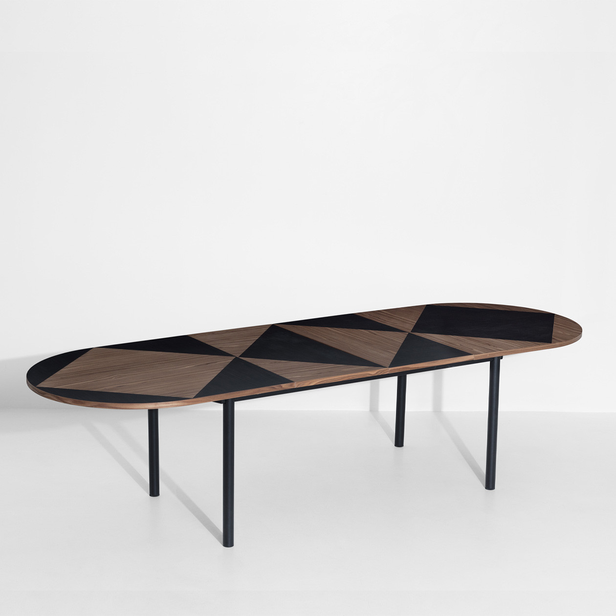 Tavla Extendable Oval Table - Tavla inspiration comes from the personal story of Léa, who's part Iranian, and has been admiring the work on backgammon tables, Tavla being the Iranian word for backgammon. Tavla table is a modern take on the traditional technique of marquetry: Pool studio created a strong and graphic design using the most classical technique. They used two different colours of walnut wood to create a contrasted pattern on the tabletop. | Matter of Stuff