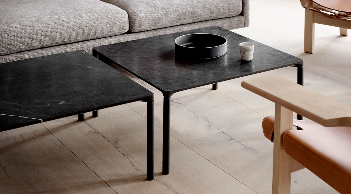Piloti 6760 Stone Coffee Table - With its simple, unadorned silhouette and slender profile, Piloti in stone exudes a unique kind of elegance. The extra appeal is all about the subtle detailing of the table top´s edge ensuring a seamless transition to the legs which merge into a balanced entity. The impression is a single line floating on four delicate legs. The Piloti stone tables all have the same height, which makes them ideal to place individually or together in a space to create a sense of continuity.