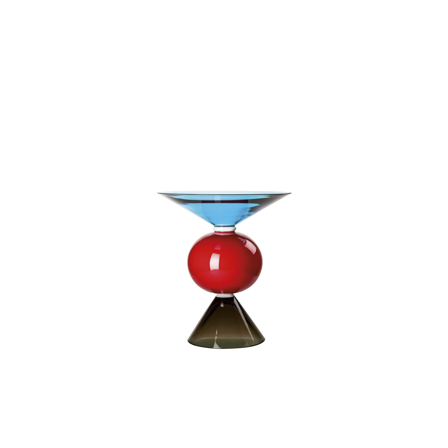 "Yamen and Oman Vase - Bold and elegant, this vase as designed by Ettore Sottsass in 1984. It comprises three separate pieces of mouth-blown glass: two flared, funnel-shaped pieces in red and blue flanking a central black sphere. This piece is crafted using the opaline technique, in which milky-white glass (""lattimo"") is superimposed with layers of transparent glass. 