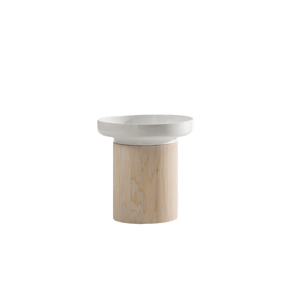 Apu 2 Side Table - APU is the Finnish word for help – because the occasional tables are on hand to help. Designer Hanna Ehlers is half-Finnish and likes to give her designs Finnish names. The APU occasional tables are a hybrid of a table, plate and vase. APU adds a further member to the family of pure materials used at ZEITRAUM: white utility pottery, with a new function and a new aesthetic.  APU is available in oiled oak, colour stained oak, oiled American walnut for the base and removable white ceramic pot for the top.   For colour stained oak options, please refer to the catalogue. | Matter of Stuff