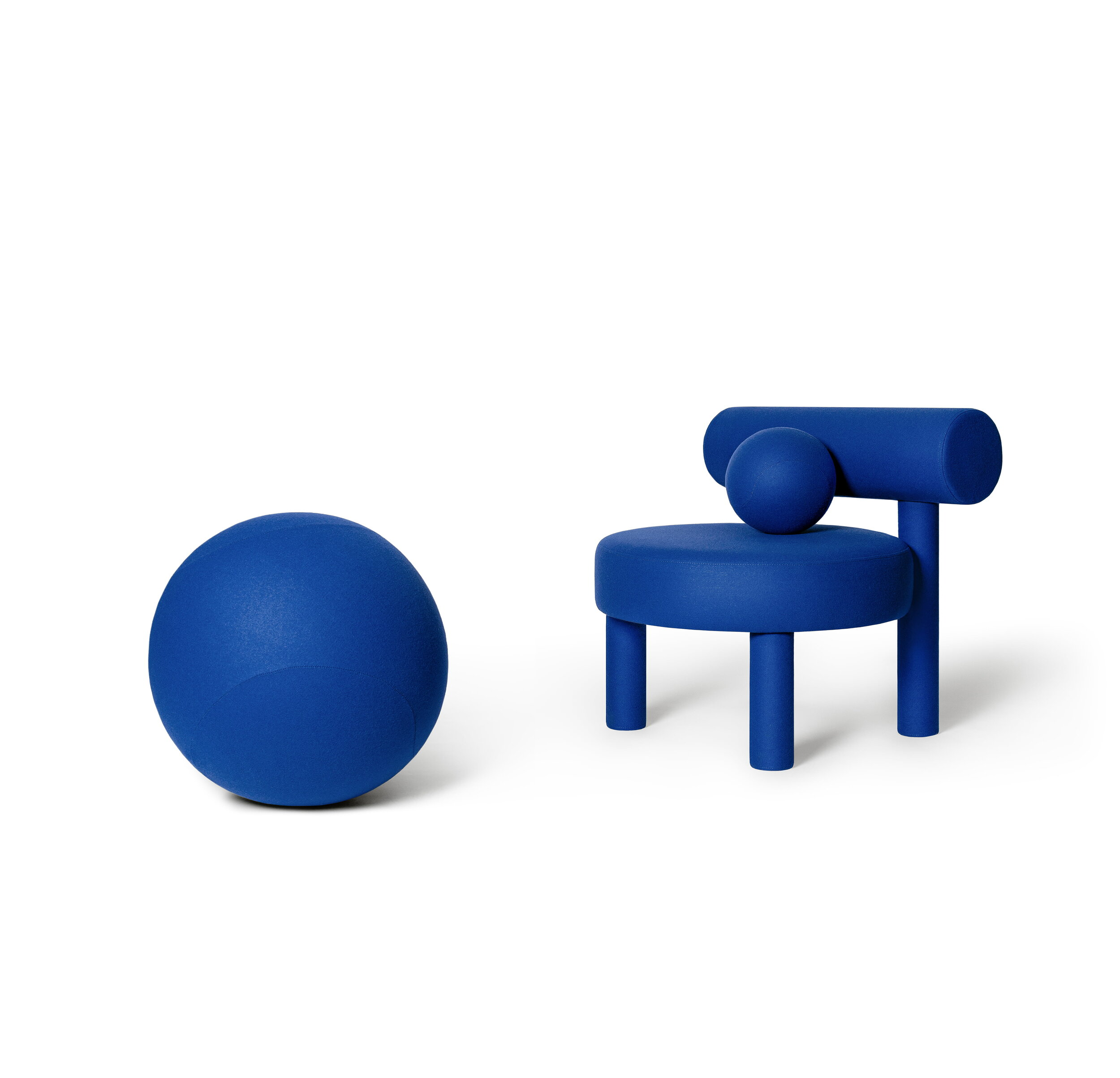 """Low Chair Gropius CS1 - New NOOM furniture collection is dedicated to the 100th anniversary of the founding of the Bauhaus School in Germany. Ideas of functionalism and conciseness, the combination of craft and art, buildings and objects formed by a composition of simple geometric shapes, are still relevant. NOOM furniture is a tribute to the great thinkers who formed the modernist principles and brought them to life.   The designer has """"gathered"""" the shape of this chair from balls and cylinders. A round pillow and an ottoman appeal to interact: to pump, to play, to bubble.  All products in the collection are called by names of famous modernist artists and architects.   Matter of Stuff"""