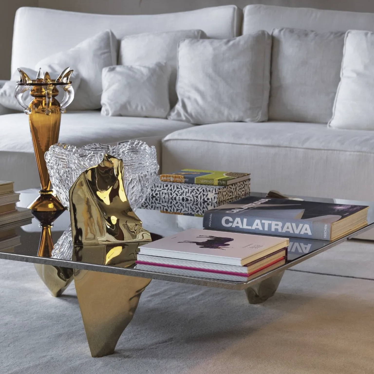 Sereno Coffee Table - In Sereno Fredrikson Stallard create a moment of calm and solitude. The forms themselves are created from shards of glass violently created by the artists, but they become unified in utter stillness by the inclusion of a simple flat sheet and the transformation of the group into polished stainless steel. This brings a reflection of the three unified elements in the surface, creating another of fredrikson stallard's recurring themes, rorschach like symmetrical forms. This even further delivers their nature from turmoil to serenity - they resolve themselves through the reorganization of symmetry. | Matter of Stuff