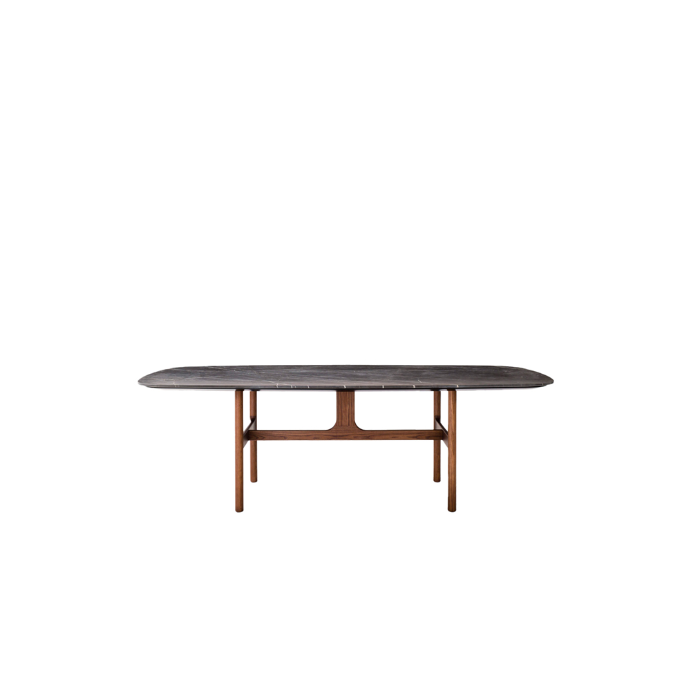 Torii Table - Inspired by ancient Japanese temple gateways, the Torii table comprises a frame featuring a central element in an inverted T shape that connects gently with the top. Presented in elegant material and colour combinations, its top can be in marble or lava stone, in either the rovere carbone or noce canaletto finish, or any of the matt lacquered colours, while the legs come in rovere carbone and noce canaletto finishes. | Matter of Stuff