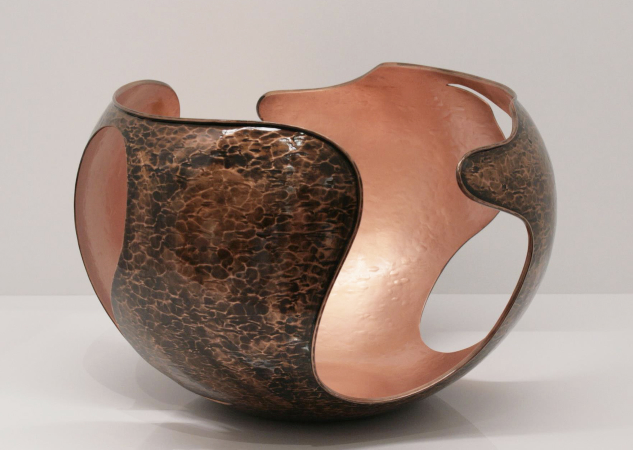 """Eterica Bowl - This unique bowl was made in copper with a varnished finish and plays with the concept of empty and full volumes recreating the silhouette of a sphere cut in several parts with the shape of a pear. Part of the limited edition """"Masterpieces"""" series that uses noble materials to create objects that go beyond the limits of tradition, this piece will be an elegant centrepiece on a dining table or a versatile bowl to place in an entryway. 