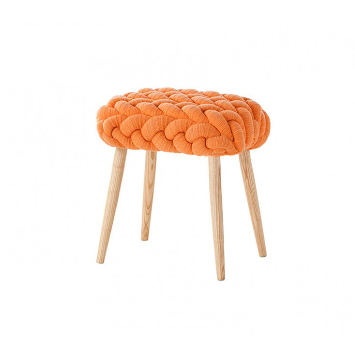 Knitted Orange Stool - Craft, with a touch of magic. Inspired by real stitches and woven yarns, these knitted stools magnify the concept and make it into a completely new item: a comfy seat. This stool has been hand kitted and due to the handmade nature of the GAN product, slight variations in size, colour, finish are normal. 