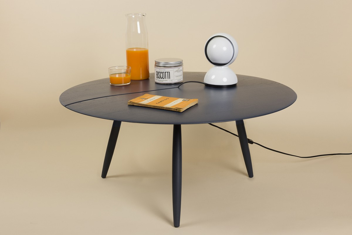 "Orio Side Table - <p>Small solid wood tables. Orio is the result of a painstaking process that allows both the legs and the round tops to be produced on a lathe. The ""incision"" in the top is a functional innovation, making it possible to conceal the wire of a lamp or a phone charger, while revealing the material essence of the selected wood – solid walnut or lacquered ash.</p>  