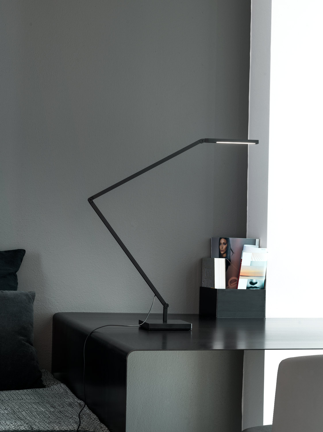Untitled Table/Wall Linear Lamp - <p>Family of table, floor and wall LED lamps in extruded matt black painted aluminium with joints for flexible and dynamic positioning of the light.<br /> Available in the version with the linear lighting unit in polymer filled with glass fibres that rotate on itself and in the version with a cylindrical spotlight in aluminium. Dimmer on board located on the lamp stem.</p>  | Matter of Stuff
