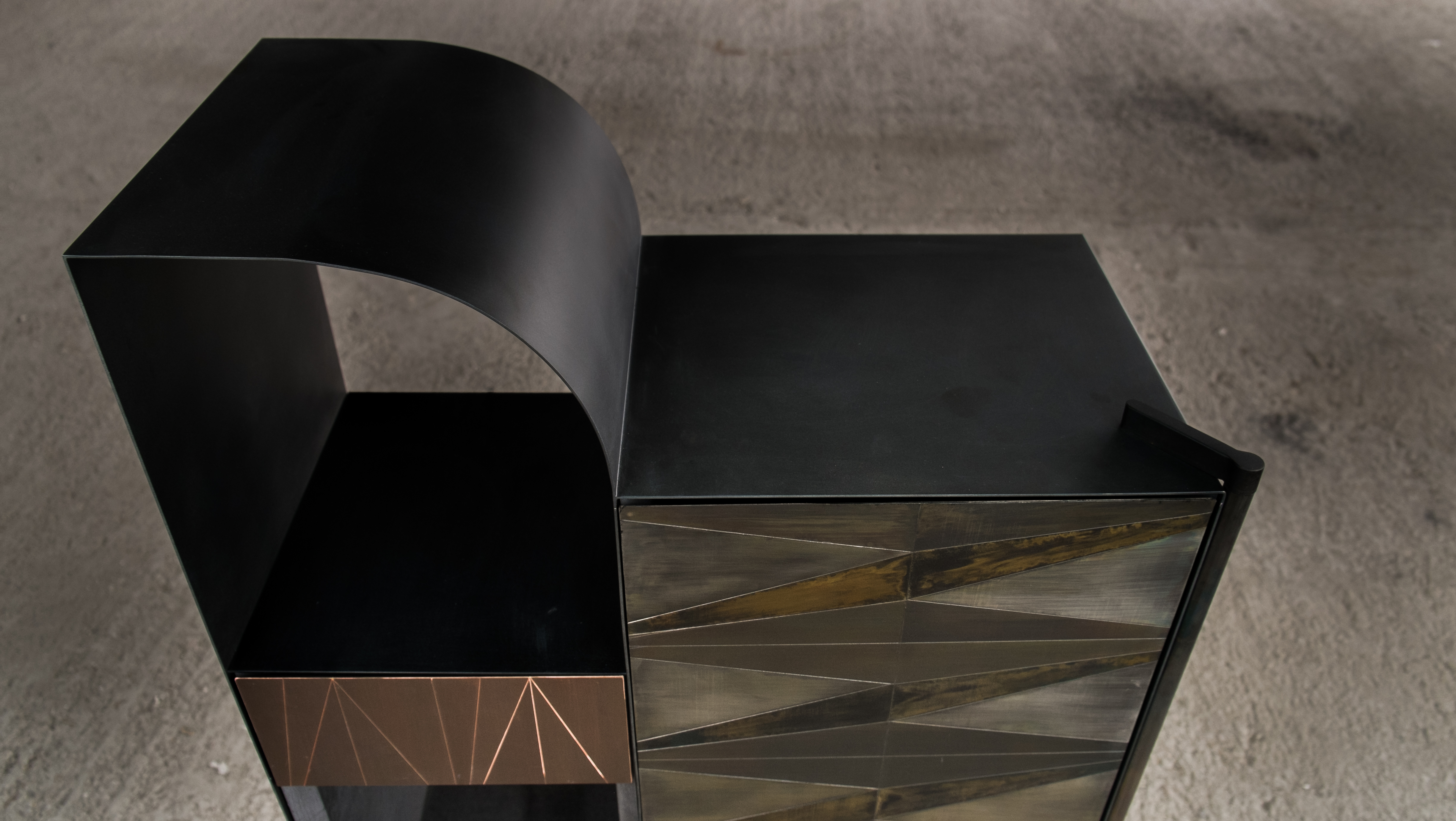 Marque' Console - <p>The collection by Alessandro Zambelli comprises a series of storage furniture that include a small cabinet, a dry bar, a console and a coffee table, where the metal inlays remind of those traditionally found in Art Deco wooden furniture, adding a new element of character and prestige. The linear essentiality of the forms, which is reflected in each element of the collection, is enriched by the presence of precious superficial decors that are juxtaposed through inlays: small metal oxidised plates animate the surface of each storage element with their refined alternation of delicate geometrical motifs. The oxidation process brings a unique mutation of the surface itself, enriched by a whole variety of shades and gradation.<br />