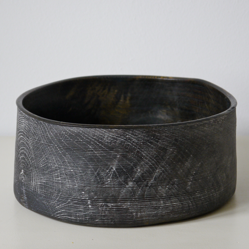 Bowl 02 - The artistic work of the trained carpenter and film-director Fritz Baumann is expressed in award-winning films and unique works in wood. No. 02 Bowl is hand carved inOak, then ebonized and limed.  | Matter of Stuff