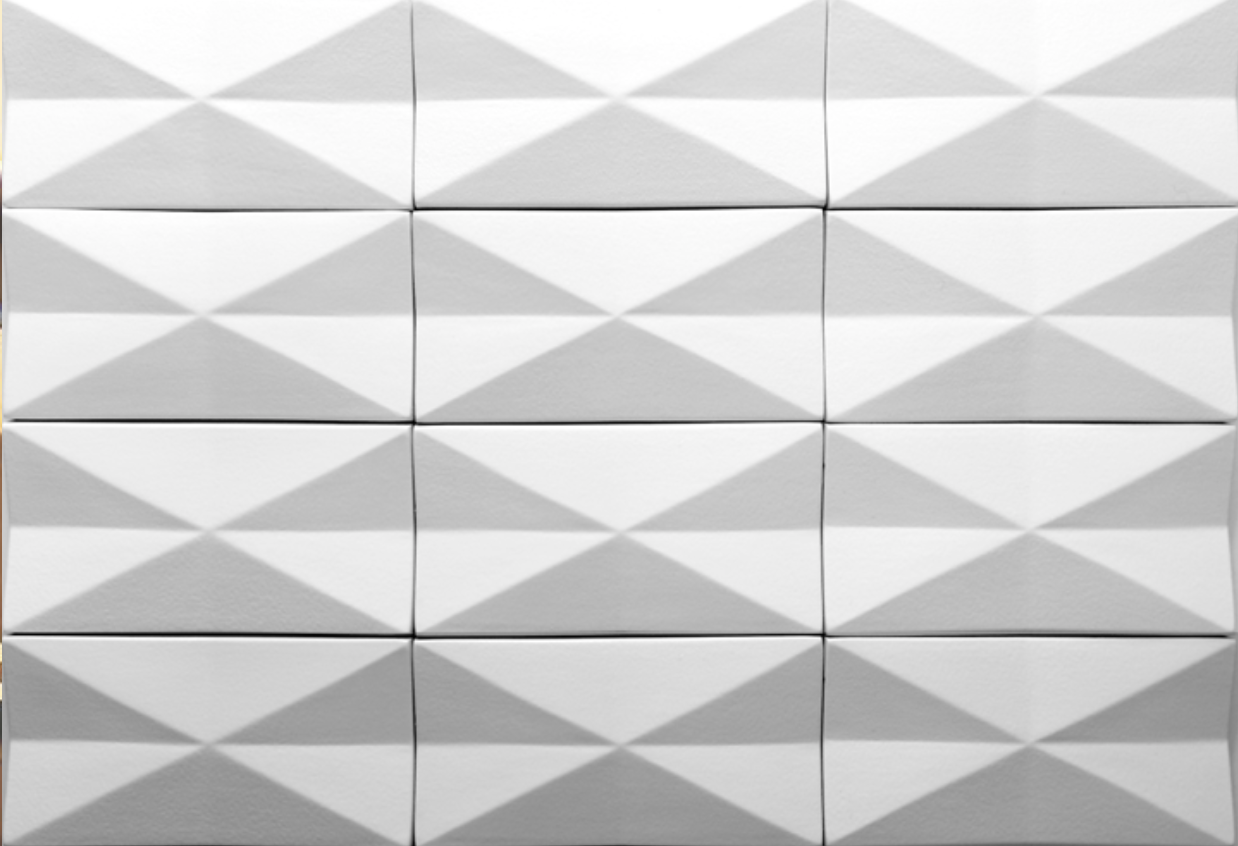 Inverted Diamond  - These ceramic tiles are sized 10x20cm and perfect to decorate exterior facades and interior walls, adding a geometric sense of movement and creating 3D surfaces profiles that playing with shadow and light. Inverted diamond tiles are produced in accordance with a hand-crafted technique which makes the material heterogeneous, both in the effects on the surface and in the dimension of the pieces. Custom glazing colours and effect are available.  Get in touch to produce a bespoke profile at bespoke@matterofstuff.com  | Matter of Stuff