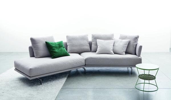 Quinta Strada Modular Sofa - Launched in 1996, the Quinta Strada seating range represented a pioneering design in modern style. Streamlined yet modularly flexible, the range has since then been restyled and re-produced with a sensitivity that is mindful of the new contemporary language. The black chrome finish of the feet, the thinner joining clamps as well as the lightness of the base and back support are elegant touches aligned with modern lifestyle. The various elements in the Quinta Strada collection allow for numerous configurations and particularly interesting compositions even in corner situations.  This item is available in various sizes and combinations. Please enquire for more information and prices.  Materials Base in plywood and metal, back in honeycomb-panelled solid wood padded with variable-density polyurethane foam, covered with velfodera on a polyester fiber 300gr/sqm. The back is supported by steel brackets black nickel. Black nickel metal feets. The seat cushions are in variable-density polyurethane foam, covered in velfodera bonded with resin 200gr/sqm. The back cushions are padded with washed and sterilized goose down quilted into sections mixed with silicon polyester fiber and covered with 100% white cotton fabric. | Matter of Stuff