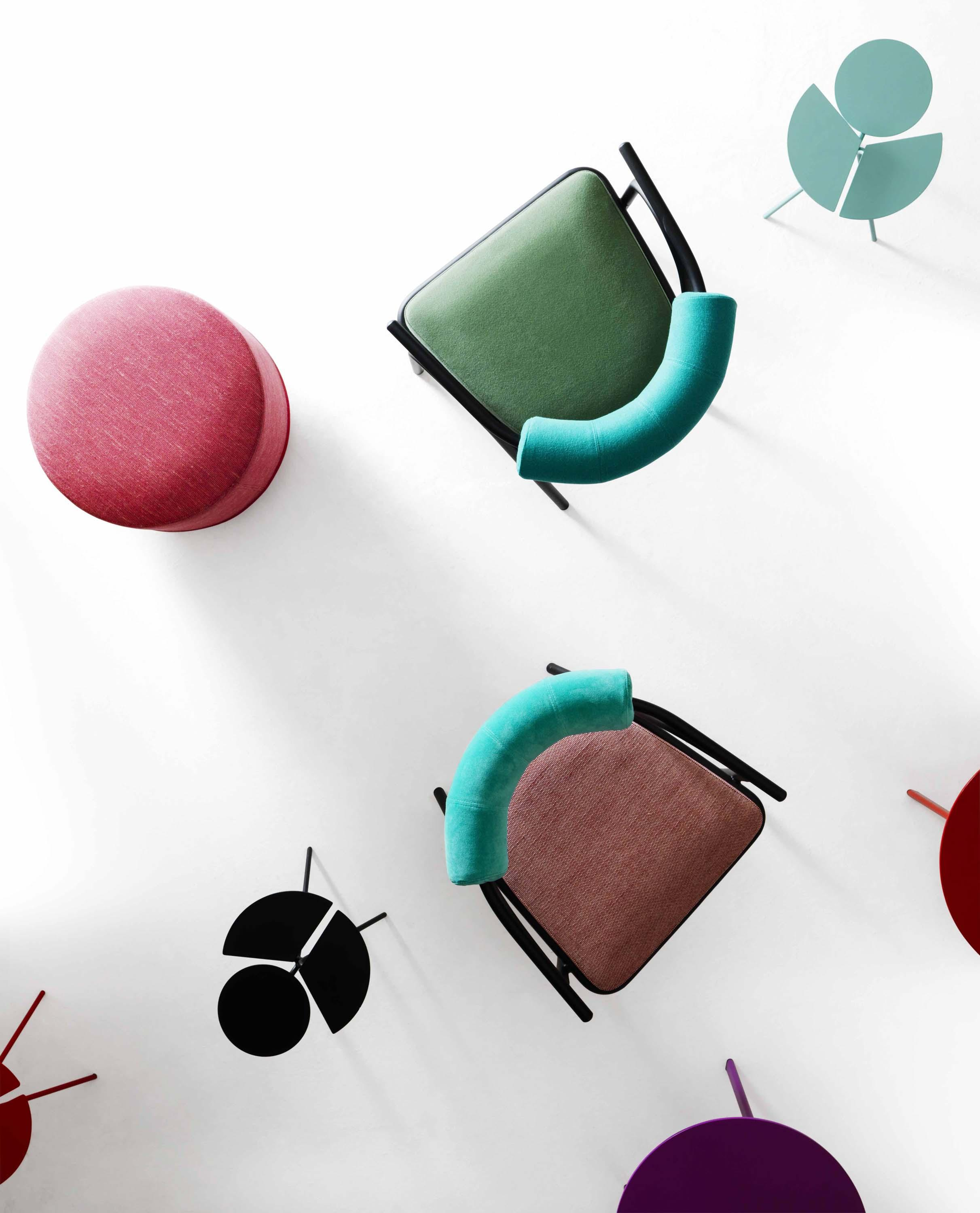 Baba Armchair - <p>Baba armchair plays the starring role in a fun game of colours and contrasts that draw their inspiration from traditional clothing and accessories used by African tribes, with the bright hues of tropical flora and the warm hues of the soil. The contrast is further emphasised in the pursuit of volumes between the backrest and seat, and the slimline monochromatic body that moves sinuously across the soft shapes of the padding.</p> <p>The armchair is made of lacquered steel frame with seat cushion and roll in polyurethane foam and polyester fiber lining. Fabric cover in mono or two-coloured.</p> <p>A range of materials, colours and sizes are available in a number of combinations. Prices may vary.<br /> Please enquire for full details.</p>  | Matter of Stuff