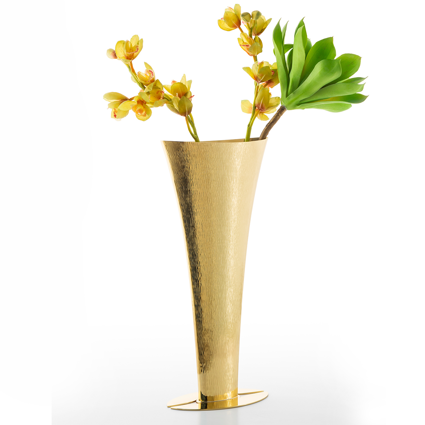 Naco Vase - The lengthy heating process of this vase's brass creates its distinct shape while successive rounds of hammering elaborately decorate the exterior. The flared shape rests on a hand-modelled base. Polished and varnished with a special protective coating, this elegant piece will enliven any corner of the house. The vase is also available in silver alloy and sterling silver | Matter of Stuff