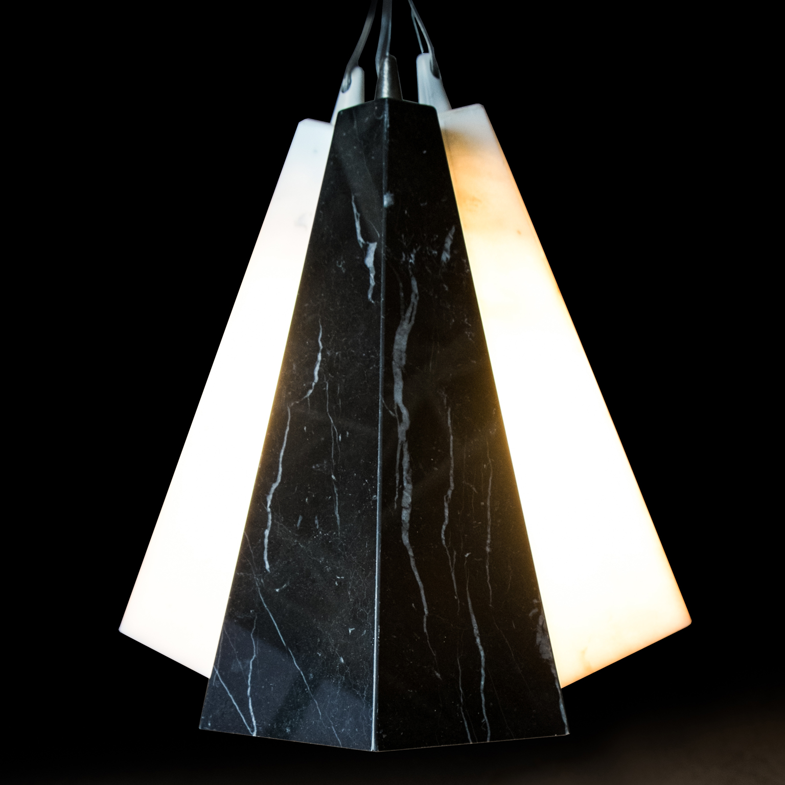 Marble Cone Pendant Light - The Marble Cone Pendant Light is a light handmade in Italy with three different types of marble. It can be used as a single element, or by adding more units it can create a modular structure that can evolve and blossom.