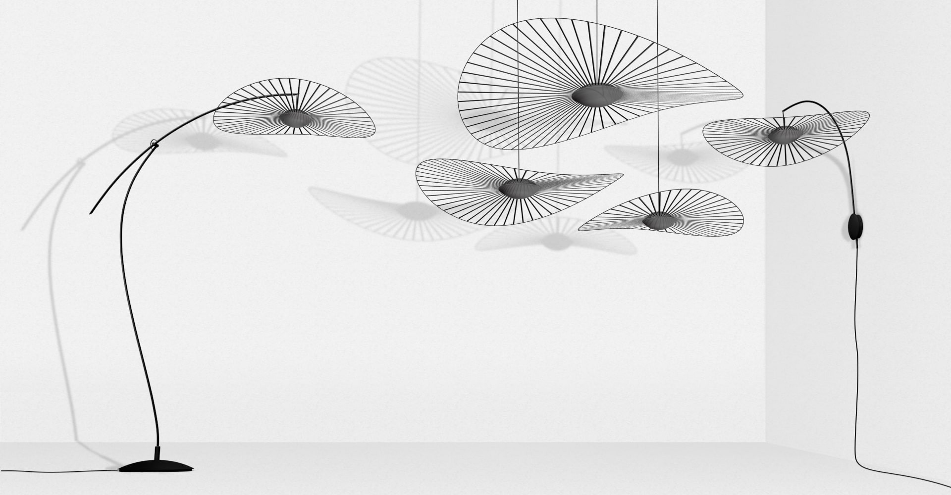 Vertigo Nova Wall Light - Petite Friture and Constance Guisset, an inseparable duo with lofty ambitions, have started a new chapter of the Vertigo story with Vertigo Nova: a highly technical piece of sophisticated design.  The collection includes items, from table and floor lamps to suspension and wall lights, all available in either black or white. The vast veil of graphic lines mounted atop a sphere of handblown glass uses built-in LED technology to emit a soft light.  Vertigo Nova quivers as the geometric curve of the fiberglass hoop. Installed by hand by qualified French artisans and held delicately but firmly in place by taught ribbons, reacts to the lightest of breezes.  Vertigo Nova is the epitome of striking a balance between technology and elegance. | Matter of Stuff