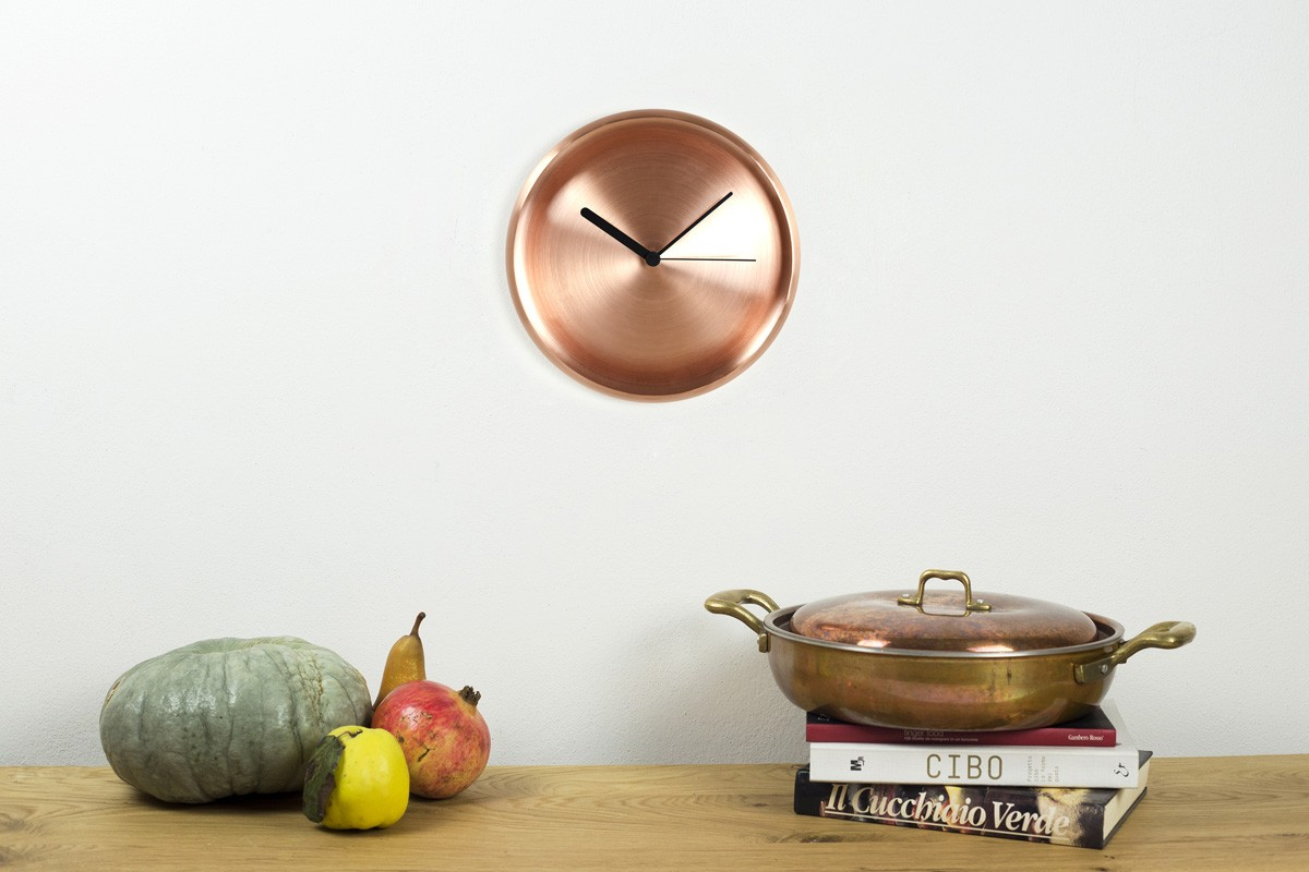 Turi Clock - <p>Memories of the Italian kitchens of yesteryear, with copper cookware hanging on the walls, almost as if to advertise the culinary skills of the hostess. The minimal style of today's kitchens banishes clutter, whose sole vestige marks the passage of time... The contemporary design of Turi is enhanced by soft forms in the traditional material, skilfully crafted by hand.</p>  | Matter of Stuff