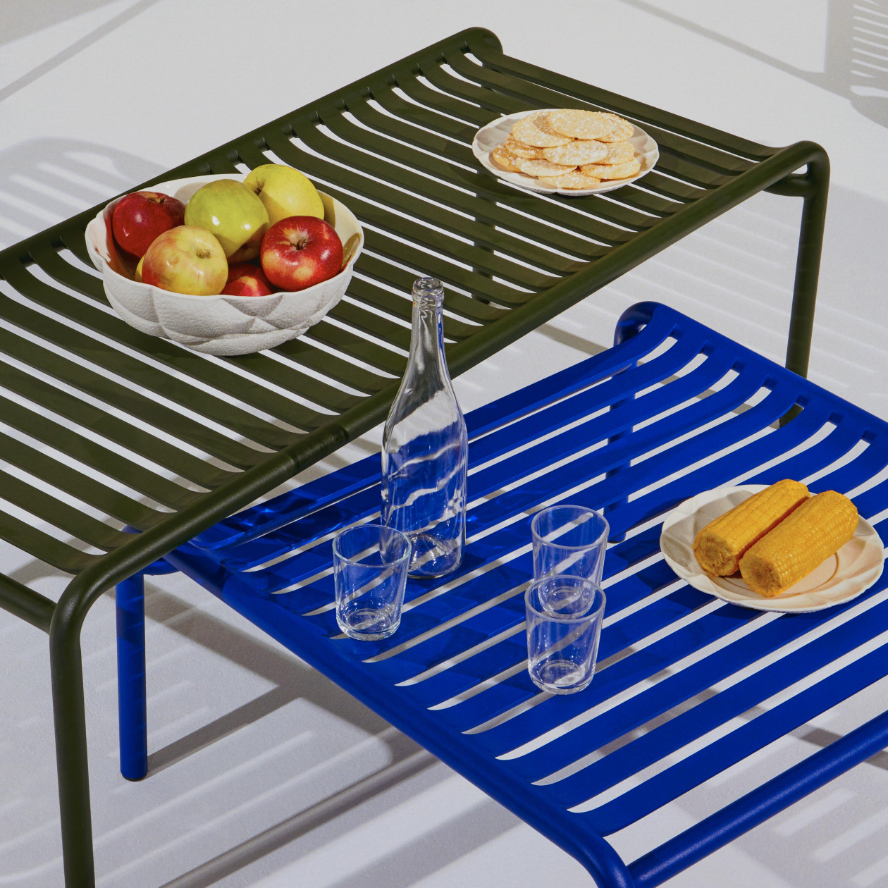 Week-End Coffee Table - The WEEK-END collection is a full range of outdoor furniture. Designed with practicality in mind, all of the seats are stackable. The Week-End collection is a complete range of outdoor furniture. The oval and circular shape drawn by the backrests makes them a graphic statement. The impact of the horizontal and vertical slats, so similar to stripes, highlights the full and empty spaces, asserting the identity of the collection.