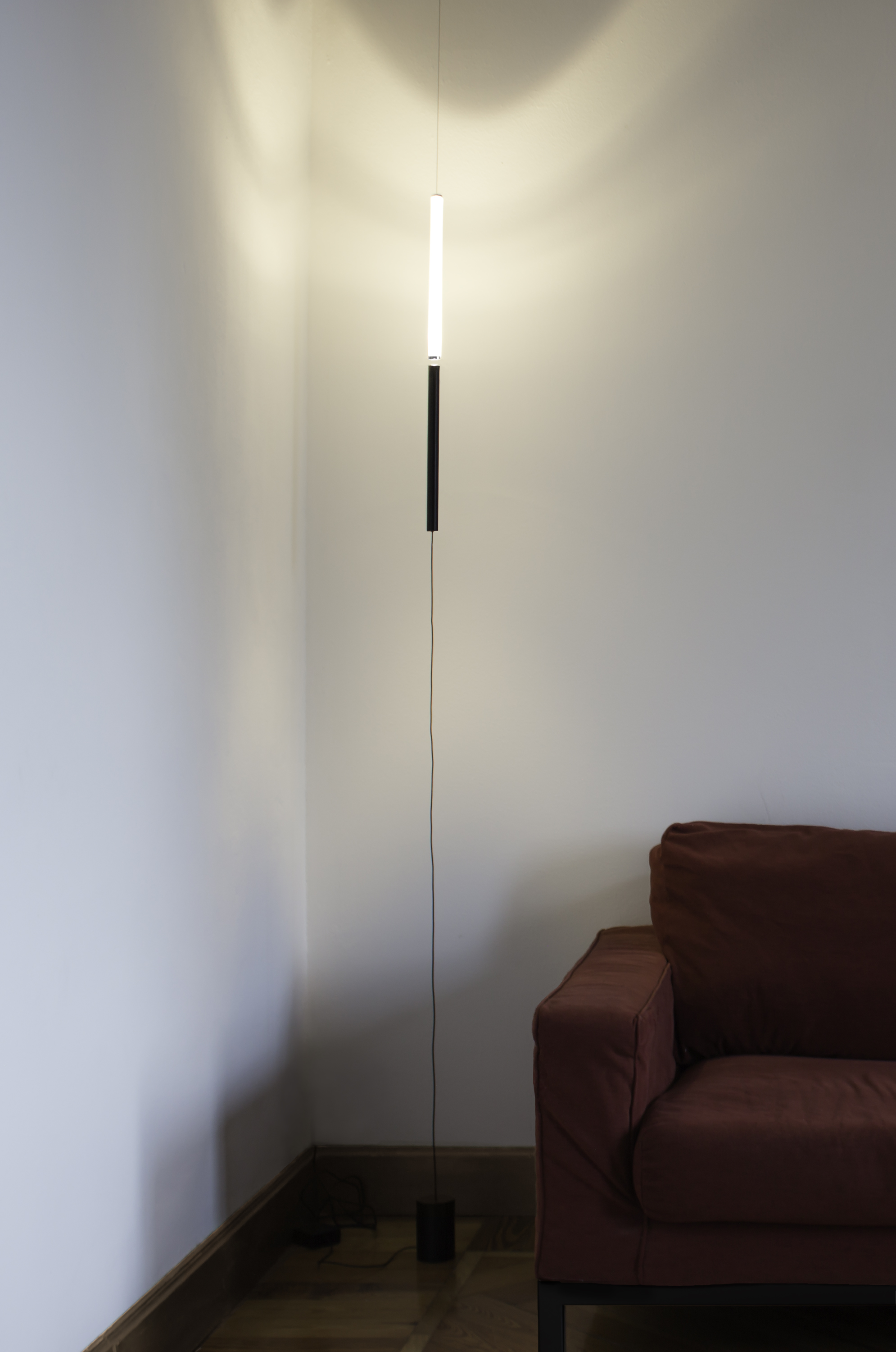 Equilibrio Floor Lamp - <p>We live inside a Universe where everything that matters is kept together by few fundamental forces in a continuously floating state of equilibrium. The existence of the cosmic equilibrium has always been considered a fascinating phenomenon of compensation. EQUILIBRIO lamp is based on the same phenomenon : the balance between gravity and magnetic force.</p> <p>EQUILIBRIO is a lamp with no structure. When the two ends of the lamp are close, the magnetic force in between them becomes strong enough to challenge gravity, letting the lamp magically float in the air. <br />Thanks to its design, EQUILIBRIO can have a more diffused light when the two ends of the lamp are perfectly aligned, allowing the light to spread from the bottom to the top part. Breaking the balance by taking the lower part, the light source can be used as a direct light.</p>  | Matter of Stuff