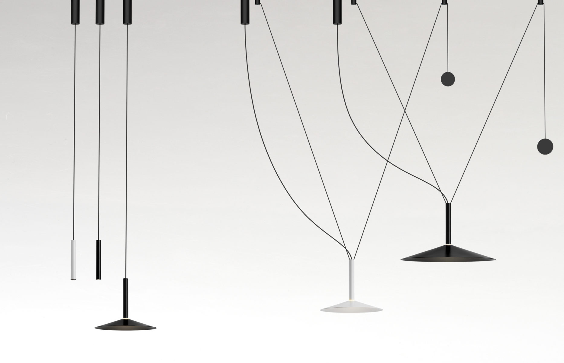 Milana Counterweight Pendant Light - Tubular structure and lacquered aluminium shade with a translucid polycarbonate diffuser. Cable with a counterweight that allows moving the lamp throughout the space.  Moving the point of light, that's the idea behind the new design by Jaume Ramírez. Milana involves a system of modular suspension lamps that combine with one another and can be moved both vertically and horizontally.  Paradoxically, this new design starts by deconstructing the archetype of a lamp; by synthesizing it as much as possible, only a cylindrical body remains, suspended with a built-in LED. To this cylinder we can add different conical shades in oyster white, black, beige, grey or red, in several sizes. But most ingenious of all is that each of these lamps can have a simple counterweight such that when they are hung between two points, they can be moved.  An almost imperceptible lens covers the LED and distributes the light. If only the cylindrical lamp is used, the downward-directed light is impeccable, and when a shade is added, the light escapes, illuminating the lamp itself. This new lighting system gives the user control of the light, offering a new conceptual proposal.  Covering and baring lamps, moving them up, down and sideways. Mixing cylindrical shapes or combining them with decorative lamps. Milana lets you create countless compositions, a symphony of light. | Matter of Stuff