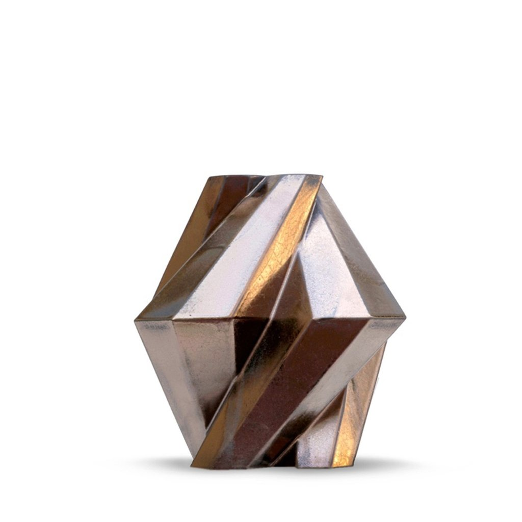 Fortress Pillar Vase Bronze - <p>Designer Lara Bohinc explores the marriage of ancient and futuristic form in the new Fortress Vase range, which has created a more complex geometric and modern structure from the original inspiration of the octagonal towers at the Diocletian Palace in Croatia. The resulting hexagonal blocks interlock and embrace to allow the play of light and shade on the many surfaces and angles. These are handmade from ceramic in a small Italian artisanal workshop and come in different finishes.</p>  | Matter of Stuff