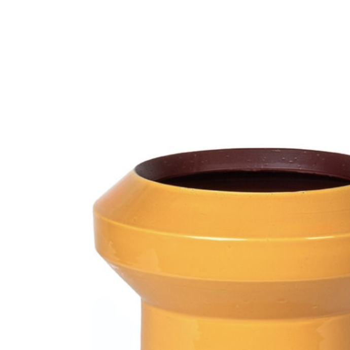 Tribe Yellow and Brown Vase - Conveying a joyful yet rigorous flair, this ceramic vase is characterized by sharp, geometric lines and a two-tone finish in warm hues: yellow on the outside and brown on the inside. Its spacious silhouette rests on a cylindrical footed base and displays a wide neck visibly tapered towards the mouth. This piece from the Tribe Collection by Arik Levy was showcased at the 2019 Milan Design Week.  | Matter of Stuff