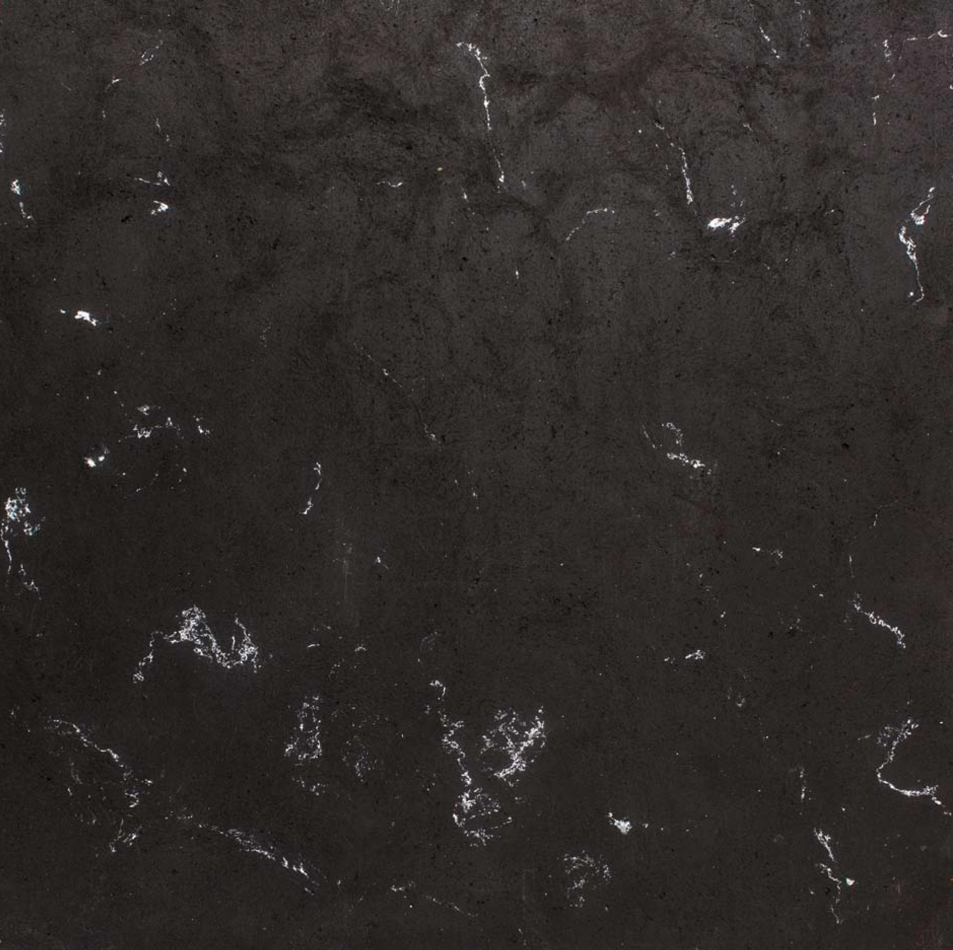 Dark Grey with White Veins - Pigmented veining flows along the sides of the impasto, oriented by the action of gradual manual pressure, thus imbuing the charm of a minimal, frozen movement against vast neutral backgrounds. Easily adapted to the greatest gamut of design solutions, Veins generates a spatiality that is unencumbered by colors and oriented toward the play of light. Reminiscent of marble, of stone, of wood, of the mosses and lichens of Salento, of time that marks and makes its own the calcareous stone. The lines confound and cross casually, and after the various phases of processing, they declare themselves in their continuous beauty. | Matter of Stuff