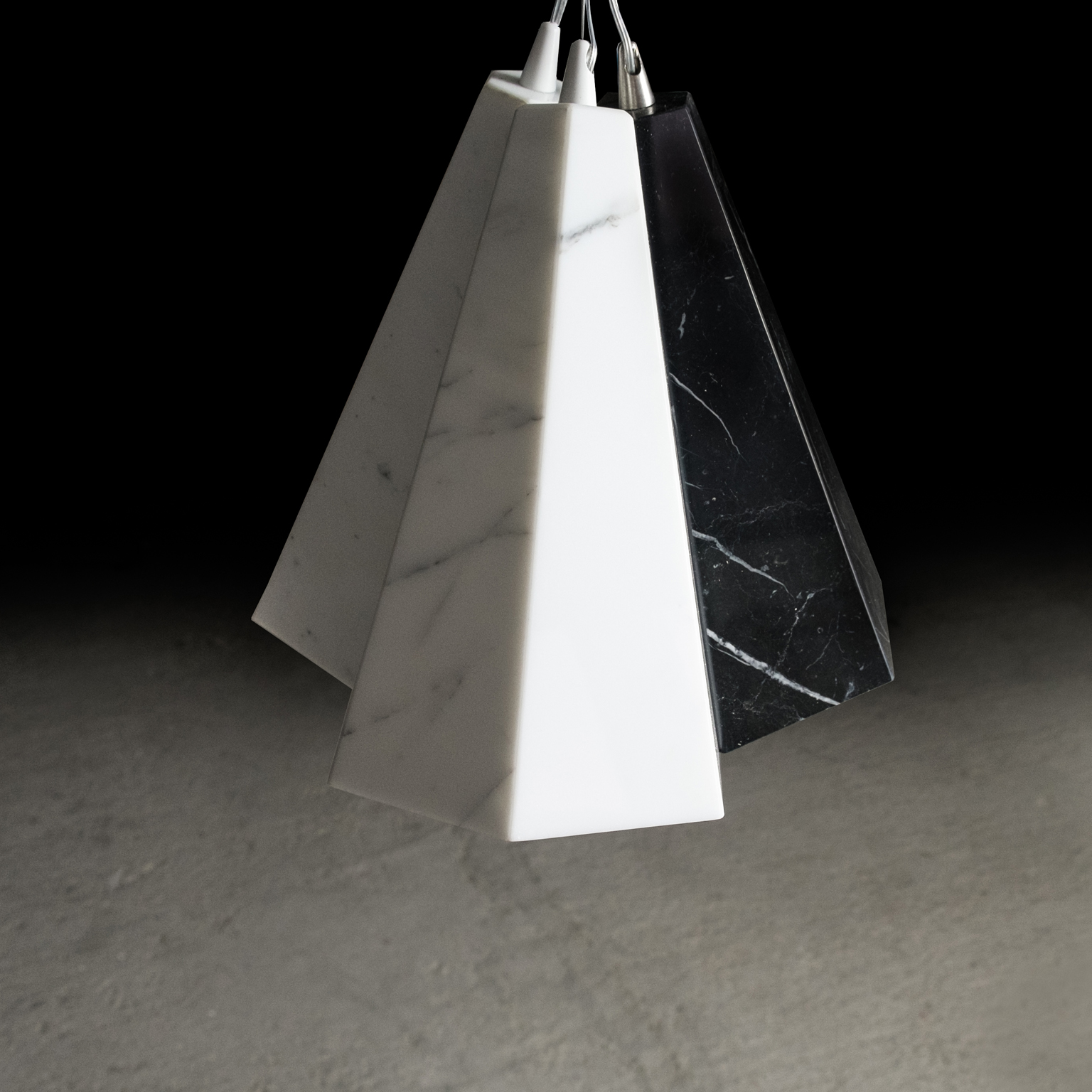 Marble Cone Pendant Light - The Marble Cone Pendant Light is a light handmade in Italy with three different types of marble. It can be used as a single element, or by adding more units it can create a modular structure that can evolve and blossom.  Each piece is sold individually.   Matter of Stuff