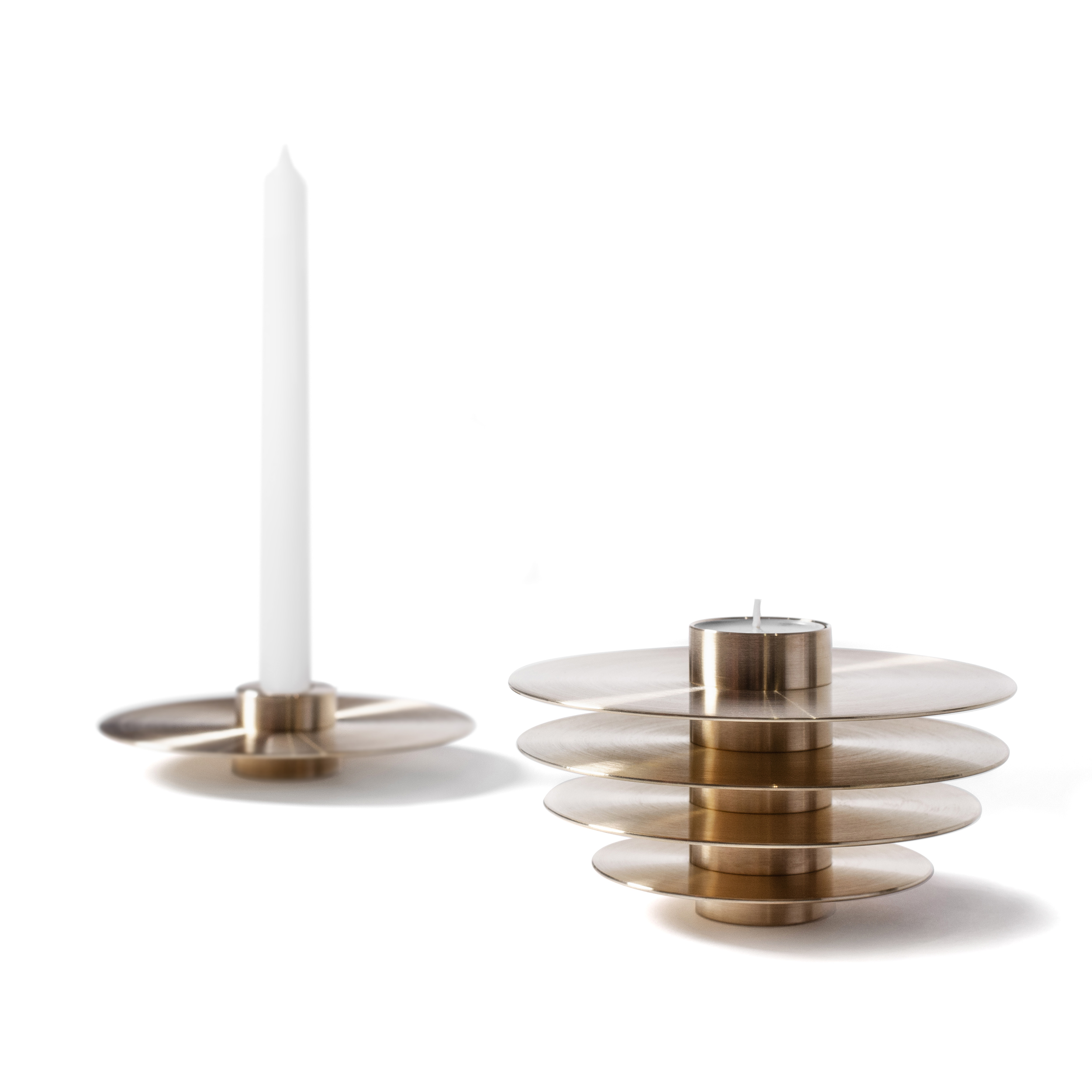Modern ORB Candle Holders Set CS1 Brass - ORB is a set of seven metal candle holders stacked on top of one another to form a modern spherical sculpture. Designed to be functional, each candle holder has two sides to hold long and tealight candles. The collection comes in solid brass and stainless steel making it look charming in any interior setting as a series of seven candle holders or as a single sculpture.