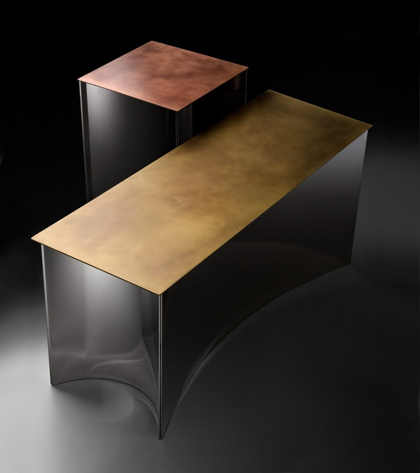 Alchemy Square Coffee Table - Alchemy is an ancient art whose main goal was to convert humble metals to precious ones, using an esoteric language to give materials a metaphysical quality. The Alchemy collection was inspired by this magic science, resulting in changeable compositions of tables that come together in immediate formal chemistry. Chromatic variations emphasise the expressivity of the materials and the concave shape of the bases refracts the luminosity of stainless steel, contrasting with the textural geometries of the copper, brass and Delabré iron tops.   Collection of 3 side tables and a bench entirely in metal, allcharacterised by a mirror polished steel base.   | Matter of Stuff