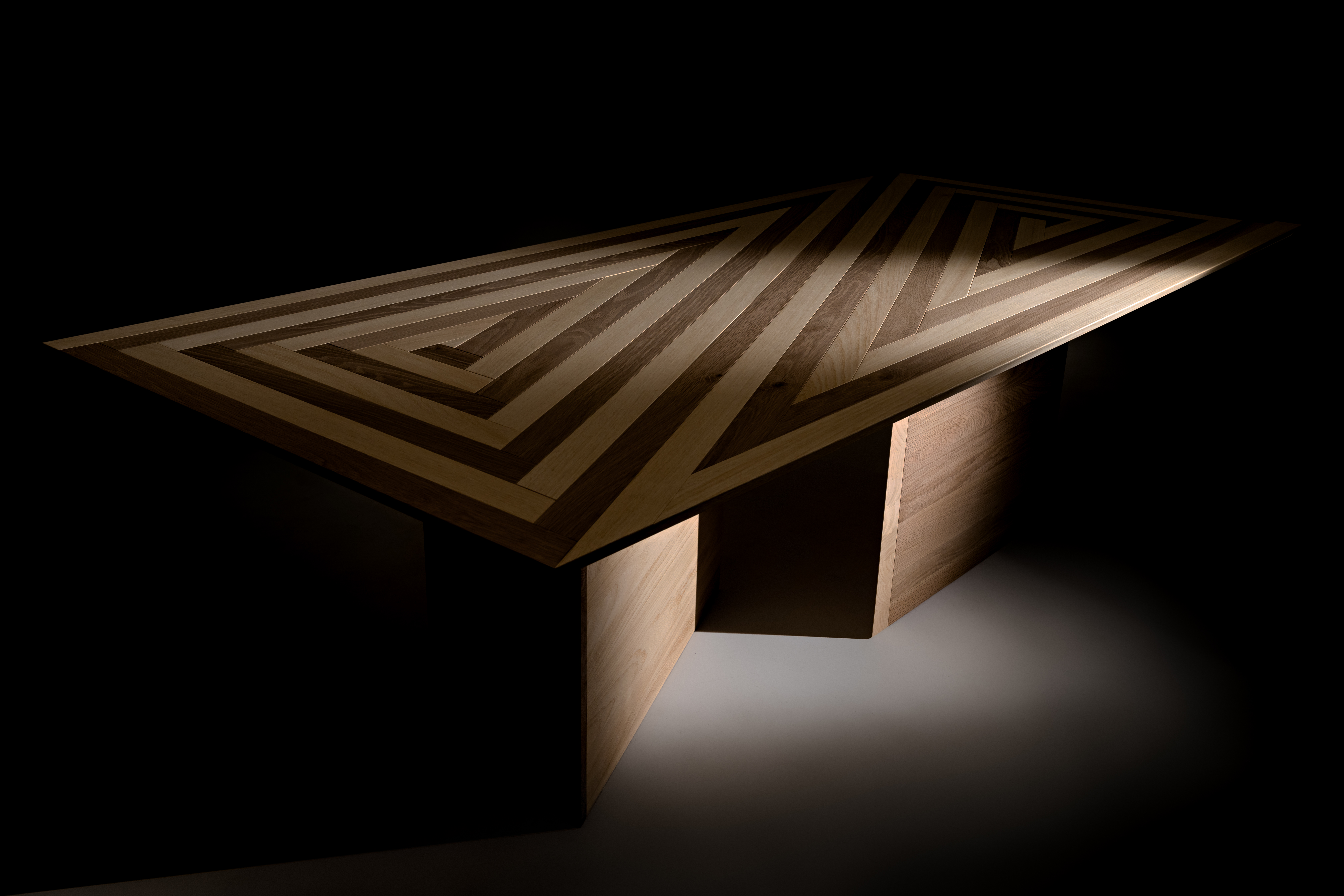 Y Dining Table - <p>Y Table, a bespoke, limited edition dining table. It celebrates diversity in design by assembling 250 hardwood slats of Cornish oak and Nigerian koto. The pieces are self-similar and yet all individually different, cut by CAD/CAM technologies and manually assembled interlocking one another via dove tail connection joints. The many discreet elements come together producing an elegant and yet functional ensemble for a unique dining piece. The design is inspired by and follows the principle of reciprocal frames, a class of self-supporting structure where every piece relies on each other requiring no centre support. Y Table fuses traditional joinery and digital fabrication and celebrate contemporary design at its best.</p>  | Matter of Stuff