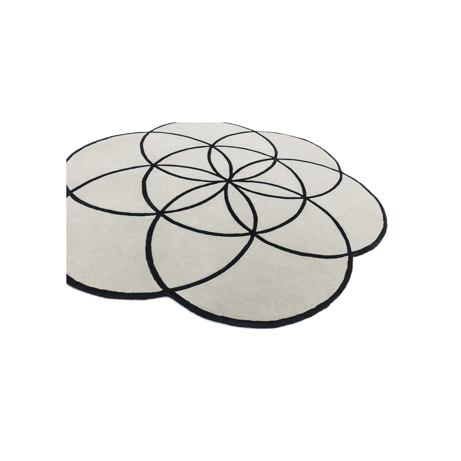 Lotus Black Rug - <p>Contemporary Design is 'of the moment' - the designs are fluid, ever-changing, eclectic and bold. Simple, subtle sophistication, deliberate use of texture and clean lines define a contemporary style of decorating. This collection illustrates this spirit. Lotus is a series of luxury tufted wool flower shaped rugs with fine viscose outline. Hand-tufted in India.  </p>  | Matter of Stuff