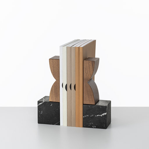 Constantin Bookends - Constantin Brancusi's totem art inspired the exclusive collection these two bookends are part of. Each bookend comprises a cubic base in black Marquina marble that supports a vertical element shaped in two curves crafted of brushed, solid walnut. The aesthetic peculiarities proper of the wood grain and the marble veining render these bookends their unmistakable, tactile appeal and visual vitality. This superb design is delivered in an elegant gray gift box displaying the Colè's logo in silver. | Matter of Stuff
