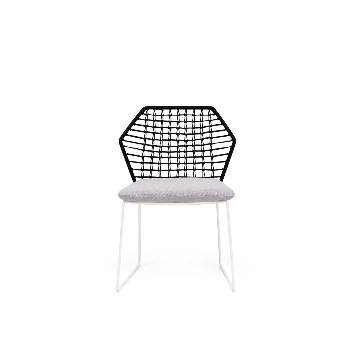 New York Soleil Garden Chair - New York Soleil is a garden chair with removable fabric cover, part of the homonymous collection.  The New York Soleil outdoor collection is a line of exclusive woven seating made entirely by hand. New York Soleil is the product of careful research into materials and the desire to maintain the unique original design. Woven nautical cords of different colours softly cover the painted metal rod structure. The ergonomic cushion is covered in a quick-drying, non-absorbent technical fabric, and its superior performance in the Martindale test guarantees abrasion resistance as well as hygienic breathability. In 2020 the collection adds a new element: the Lounge Armchair.  New York Soleil embodies outdoor living with a casual style and colourful charm. It is available in different blends and solid colours. The collection includes a sofa, a lounge armchair, an armchair, a pouf, a chair with or without armrests and a stool. Fully removable covers.  Additional removable cover is available, please enquire for prices.  Materials Structure in 16 mm wire drawn for lounge armchair; in 12 mm wire drawn for sofa, armchair and pouf; in 11 mm wire drawn for chair with or without armrests and for stools. For all elements, the structure is covered with plaiting of 4 mm diameter of polyester ropes. For sofa, armchair, chairs and stools, the seat cushion is filled with a special 30 water-draining polyurethane, covered with polyester fiber 300gr/sqm on 100% polyester lining. Lounge armchair's seat cushion is made with flexible glass fiber slats inserted in the core of variable density polyurethane foam, covered with 600 gr/sqm polyester fiber and clothed with water-repellent heat-sealed fabric. Back and armrests cushions are in polyester fiber in TNT fabric cover, clothed with water-repellent heat-sealed for fabric provided with a breathable band. | Matter of Stuff