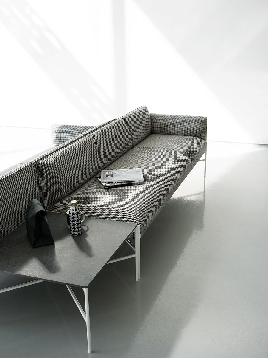 Chill-Out Sectional Sofa - Chill-Out is a system of sofas and armchairs that can stand alone or create a vast range of different linear or corner compositions.‎ It features a light, slim base and cosy, comfortable cushioning, to which back and armrests can be added.‎ An ideal combination both for domestic and collective spaces, particularly in the version with a built-in coffee table.‎