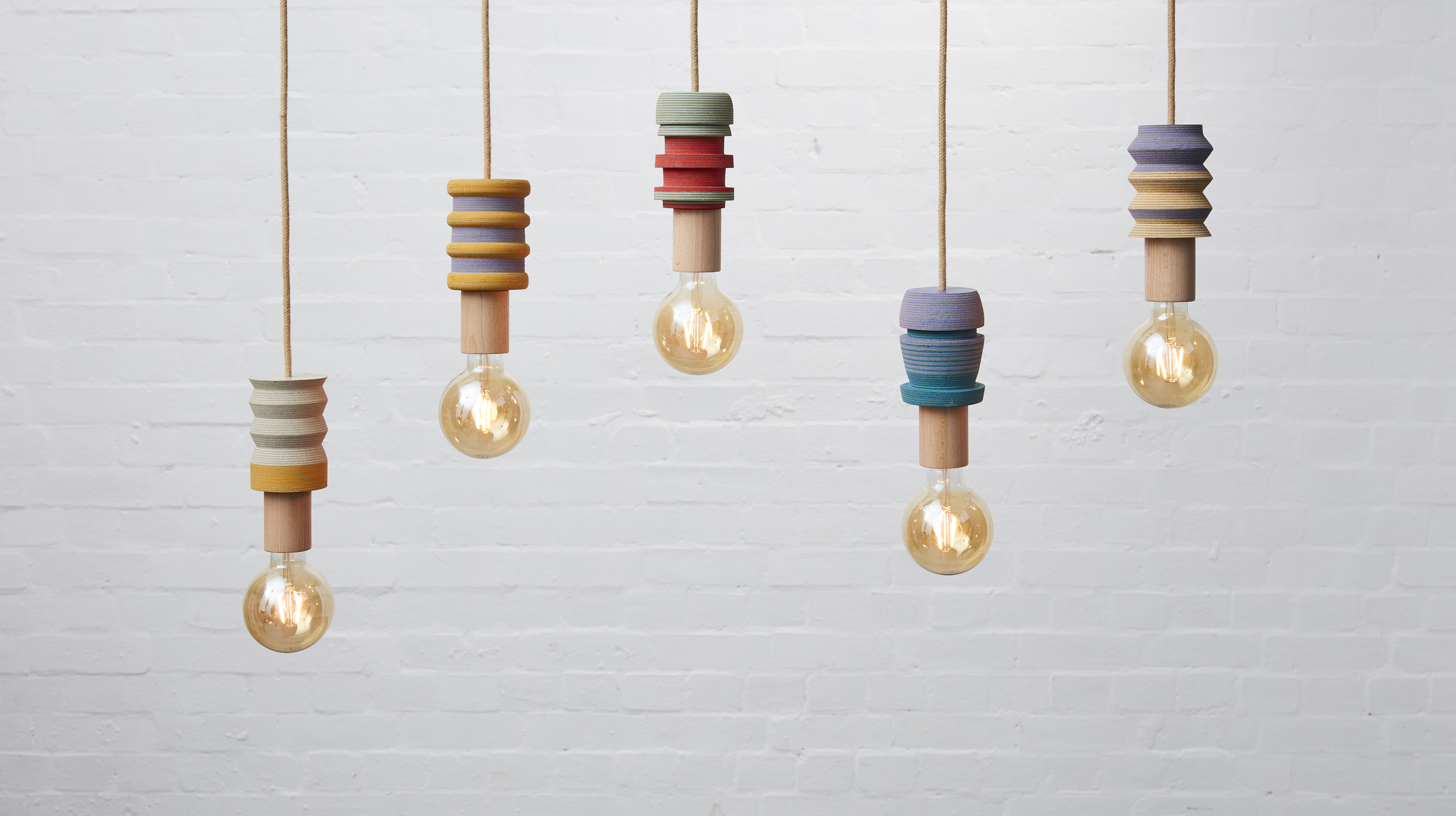Lin pendant 4 - <p>The LIN pendant lights have been turned by hand on a lathe from blocks of laminated squares of Linoleum flooring. These playful and subtly vibrant pendants have been finished with a natural jute covered lighting cord, a solid wood E27 fitting bulb holder and a standard 3 pin plug. Statement yet welcoming lighting to brighten up interior or commercial spaces.</p>  | Matter of Stuff