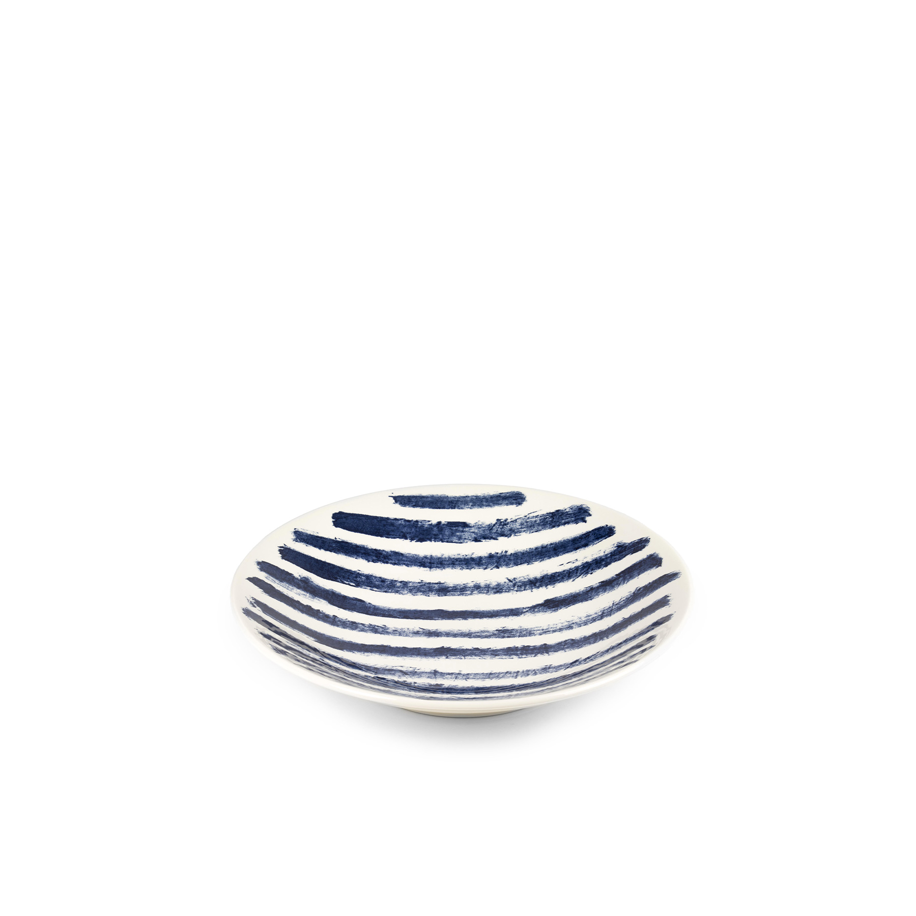 Indigo Rain Large Serving Bowl - Faye Toogood's addition to her range of ceramic designs for 1882 Ltd. puts a fresh spin on the forms and traditions of English creamware. Indigo Rain reinterprets the homely familiarity of blue-and-white striped crockery in a new design informed by the spirit of serendipitous discovery. Representing a streamlined take on our ceramic heritage, the fine earthenware employs the familiar tones of English Delftware: cream offset with a rich, deep blue. Broad bands of indigo glaze, like painterly washes of watercolour, are applied to rough canvas and then transferred to the pieces – the characteristic grain of the fabric imbues the delicate ceramics with the hardworking spirit of dark-dyed denim.  | Matter of Stuff