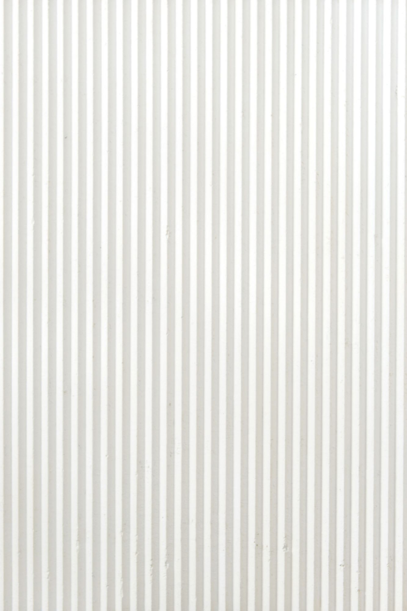 "White Ruts - Obtained by stretching the impasto first by hand and then with CNC machining, Ruts alternates between flat portions, reminiscent of stone, to rectangular sections to create a succession with a solid and fortunate rhythm. The ""cadence"" of its grooves can be more or less dense, continuous or interrupted, but in each of its versions and in all the different colors, Ruts reveals, thanks to the intervention of the machine, the material uniqueness of paper pulp. They are indeed hard, mechanized cuts that speak of the very fiber of the paper as it pushes toward new dynamic and formal borders. 