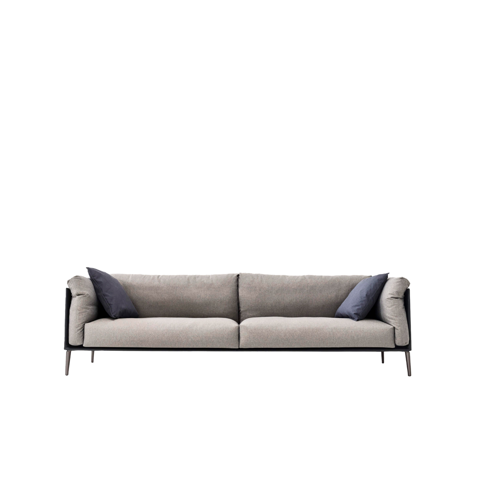 """Kubì Sofa - The invitingly soft-edged cushions and the continuous surface of the frame, with its exposed structure, shape a new way of enjoying downtime. Made up of modular sections, the Kubì sofa can be put together in different configurations, providing multiple seating solutions. It comes in straight and corner versions and is available in all fabrics, leather and imitation leather options.  To suit your interior design scheme, the sofa can be customized in two different fabrics from the same category. In addition, there is an option of combining leather or extra leather carcass with fabrics from any category. In this case, for the price refer to """"Mix"""" option if the carcass is in leather or to the """"Extra mix"""" if the carcass is in extra leather.  The frame can also accommodate a painted metal tray or magazine rack in bianco, matt lacquered or metal lacquered finish for an extra charge.  